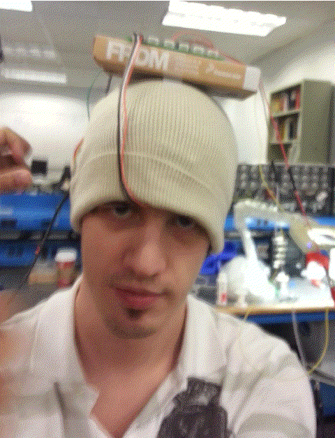 Selfie when I was wearing the cap equipped with the EEG system. Not very comfortable..